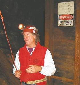 Mike Miller, president of Original Sixteen to One Mine in Alleghany, leads a tour from the Nevada County Historical Society into the shaft of his 113-year-old gold mine. For more information visit the Web at OrigSix.com or NevadaCountyHistory.org. Photo for The Union by Michelle Rindels